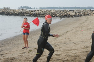 Lynne finishing the swim portion of her 70.3 triathlon on 6.30.13.